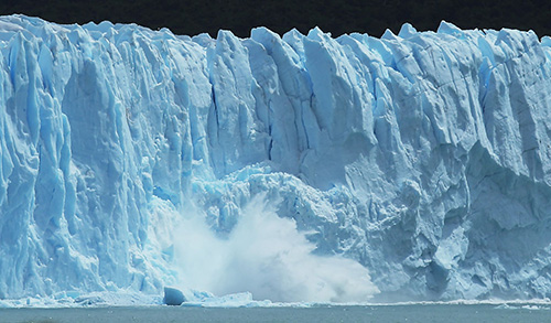 SANTA CRUZ PROVINCE, ARGENTINA - NOVEMBER 29: Ice calves from the Northern wall of the Perito Moreno glacier in Los Glaciares National Park, part of the Southern Patagonian Ice Field, on November 29, 2015 in Santa Cruz Province, Argentina. Certain areas of glacial ice take on a bluish hue due to light refraction. The Southern Patagonian Ice Field is the third largest ice field in the world. The majority of the almost 50 large glaciers in Los Glaciares National Park have been retreating during the past fifty years due to warming temperatures, according to the European Space Agency (ESA). The United States Geological Survey (USGS) reports that over 68 percent of the world's freshwater supplies are locked in ice caps and glaciers. The United Nations climate change conference begins November 30 in Paris. (Photo by Mario Tama/Getty Images)